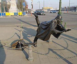 ManFallingOverSculpture